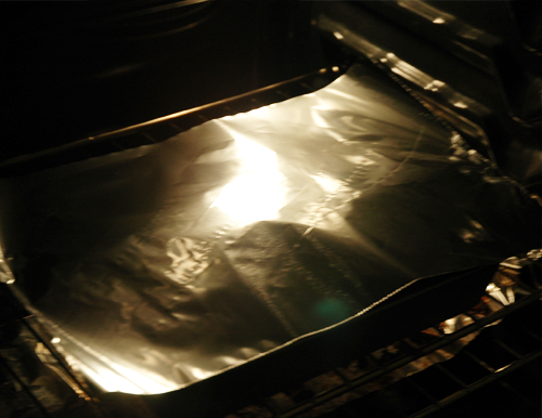 put foil over lasagna in oven
