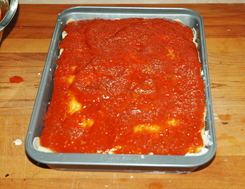 top lasagna with sauce